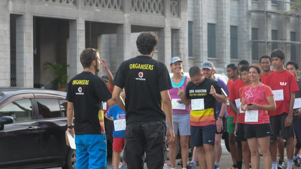 SMC members talking to runners
